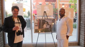 Artist Lance Bradley poses with the photograph of his Martin Luther King, Jr. mural.
