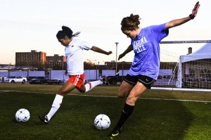 Girls Playing Soccer Involving children in sports can help to build self-esteem.