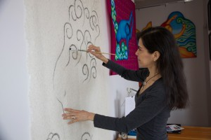 Arroyo's work is displayed – or sometimes painted directly – on fabric.