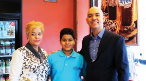 """""""It prepares you for the real world,"""" said student Xavier Reyes (with his mother Margarita Ramos) of learning with his teacher Obed Fulcar."""
