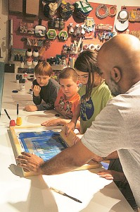 Artist Tony Peralta (right) hosts classes.