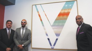 "Artist and HHC Global Ambassador Kasseem ""Swizz Beatz"" Dean (second from left) donated his painting <i>Victory</i> to the Henry J. Carter Specialty Hospital and Nursing Facility."