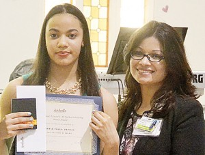 María Vargas receives her certificate of recognition; at her right is Isabella's Assistant Director of Marketing Marilyn Pacheco.