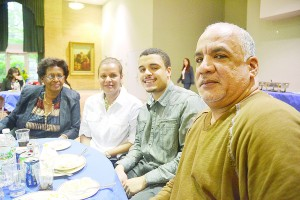 Isael Luperon (in grey shirt) with his family.