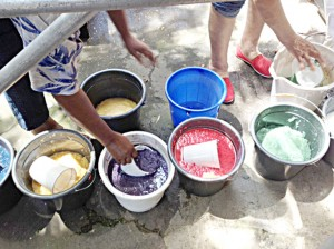 Colored buckets of pulp.